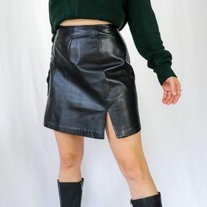 Black vintage 90s 100% genuine leather high rise mini skirt by Danier